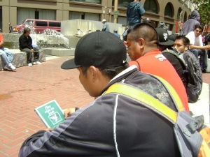 Men reading Gospel tracts