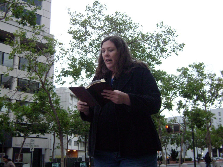 Reading God's Word out loud in public in San Francisco amidst listeners and hecklers
